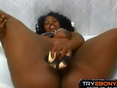 Oiled black booty gal fucks her ebony vagina