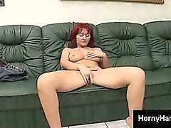 Horny redheaded MILF rubs her slutty shaved pussy on the couch