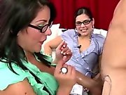 Classy CFNM babe giving a handjob to naked amateur dude