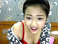 Delightful Asian camgirl with a gorgeous smile flashes her
