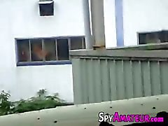 Voyeur spying a couple having Sex