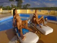 Outside foursome by the pool with a couple of hot babes and cocks