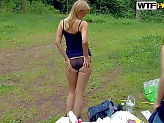 Albina and Ariana bare their asses and get nailed outdoors