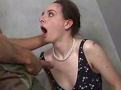 Brunette chick gets piss in a toilet