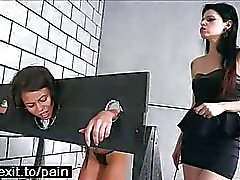 Lesbian BDSM with wooden stocks punishment