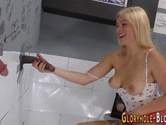 Babe sucks thru gloryhole