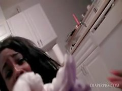 Lesbo scene with ebony sucking peed diaper