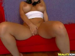 Top heavy babe Megan Jones plays with glass toy