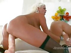 Turned on lesbian babes playing with huge sex toys