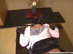 Gimp masked women tied down with dildo insertions