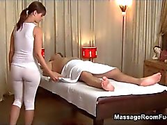 Busty brunette babe gives a sensual oil massage