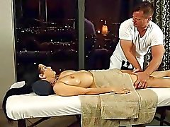 Curvy masseuse twat banged by her client on massage table