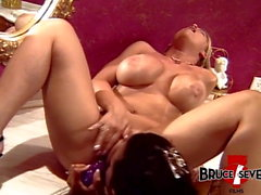 Huge tits dyke pleasing MILFs pussy and ass with a dildo