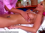 Busty blonde receives a naughty massage with happy finish