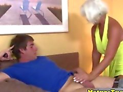 Handjob loving granny tugging on a dick