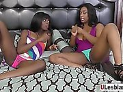 Fit ass lesbians lick and finger their chocolate pussies