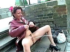 Mature exhibitionist masturbating in public and squirting on pavements by old amateur flasher outdoors