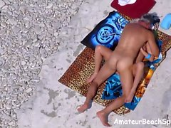 Amateur couple beach sex exposed by voyeur