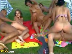 Nasty teen babes in hardcore group action while camping
