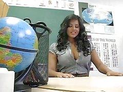 Classy brunette teacher shows off her big boobs