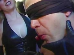 Mistresses use food to dominate their slave during his session