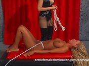 Mesmerizing blonde slave girl dominated by the merciless Natasha Sweet