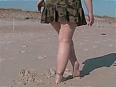 Parpadeo coño en una playa pública