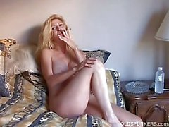 Beautiful blonde mature enjoys a smoke break