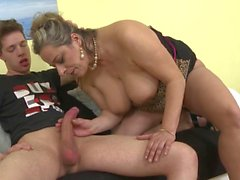Chunky mom with big tits rides hard young fuck stick