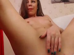 Amateur MILF toys her pierced cunt