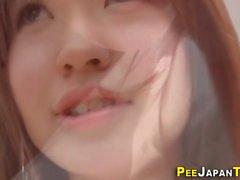 Asian teen peeing solo