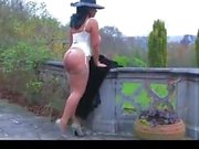 Danica Collins Takes Off Her Coat And Toys Outside