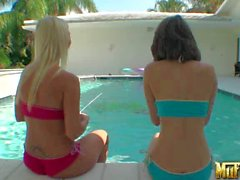 Esmi Lee and Molly Cavalli play in the pool and show their boobs