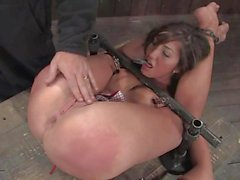 The slut was tied down as her slit was poked with fingers and toys