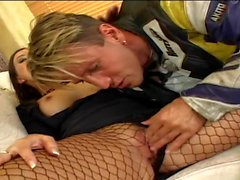 He licks her ass between the fishnets in a luxurious house