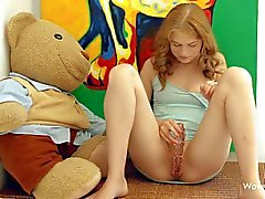 Young Ksenija A toying her hole in her room
