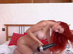 Lewd redhead playgirl in a solo clip threatening-fearsome PornDoe