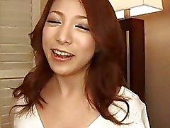Amateur Kanako Tsuchiyo kneels to suck a big dong