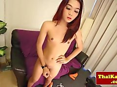 Redhead ladyboy jerking her asian cock