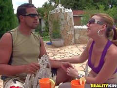pale brunette hooker with sunglasses suck cock by the pool