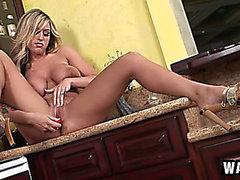 Stacked blond with hawt legs Memphis Monroe masturbates in the kitchen
