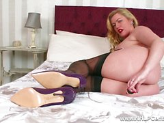 Experienced Milf Holly Kiss toys wet pussy in fully fashioned nylons kinky high heels and garters