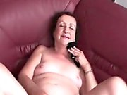 Mature hottie rubs pussy with sexy panties