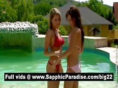 Hot brunette and blonde lesbians having fun at the pool and having lesbian love