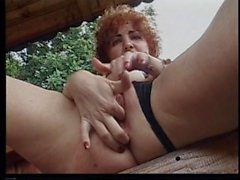 Mature redhead with pimply butt uses two dildos
