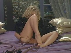 Danni Ashe On The Bed Stripping Her Black Lingerie