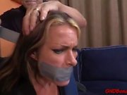 Duct tape girl gagged