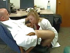 Doctor seducing obedient office nurse