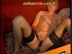 Sweet cute blonde in stockings solo