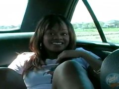 Black amateur fucks herself in a car